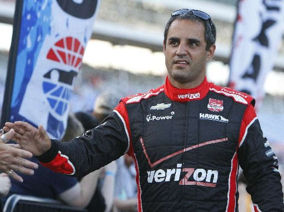Juan Pablo Montoya shakes hands with fans before the Firestone 600 at Texas Motor Speedway(David Kent/Fort Worth Star-Telegram/MCT).