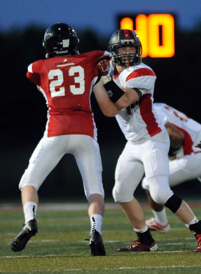 Lineman Shane Lummus, right, led the White Team to a win. Photo: Jerry Baker, Freelance