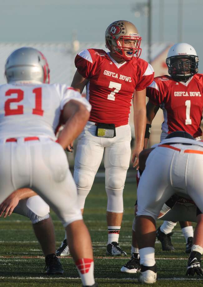 Red Team quarterback Greyson Secades (#7), from Pope John XIII, calls a play against the White Team during the 2014 GHFCA Bowl at Falcon Stadium in Huffman on June 20. Photo: Jerry Baker, Freelance