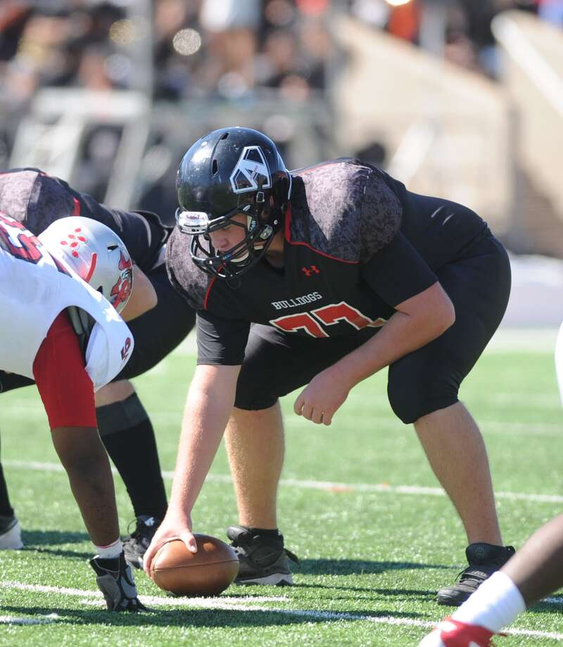 Fort Bend Austin and Fort Bend Travis played a football game at Mercer Stadium, 10-19-2013.  Austin won the game, 49-31. Austin center Tucker Kisel (77) readies himself to snap the ball in the game against Travis. Photo: Eddy Matchette, Freelance / Freelance