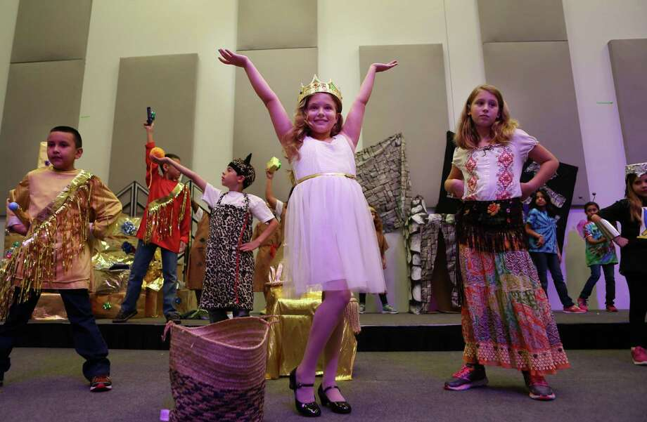 """The Quiltmaker's Gift,"" written and staged by the two dozen elementary school students in Create an Opera camp, starred Maya Credeur, center, as 'The Queen' and Emma Kay, right, as the title character. Photo: Mayra Beltran, Staff / © 2014 Houston Chronicle"