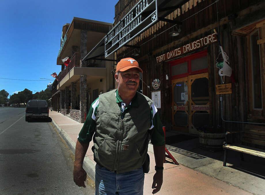Jeff Davis County Sheriff Rick McIvor leaves a restaurant Wednesday May 7, 2014 in Fort Davis, Texas. McIvor is a former University of Texas quarterback. Photo: JOHN DAVENPORT, San Antonio Express-News / ©San Antonio Express-News/John Davenport