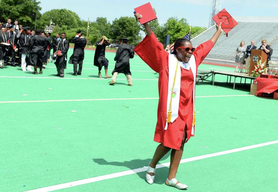 Graduate Diamond Allen celebrates during the Central High School commencement ceremony Tuesday, June 24, 2014 at Kennedy Stadium in Bridgeport, Conn. Photo: Autumn Driscoll / Connecticut Post