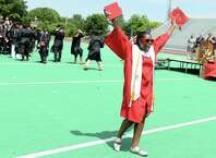 Graduate Diamond Allen celebrates during the Central High School commencement ceremony Tuesday, June 24, 2014 at Kennedy Stadium in Bridgeport, Conn.