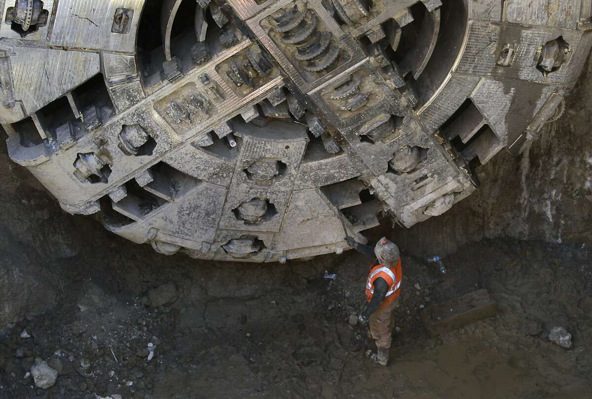 A construction worker prepares one of the two tunnel boring machines for extraction at Powell Street and Columbus Avenue in San Francisco, Calif. on Tuesday, June 25, 2014. Big Alma and Mom Chung have completed the tunneling portion of Muni's Central Subway project from South of Market to North Beach.