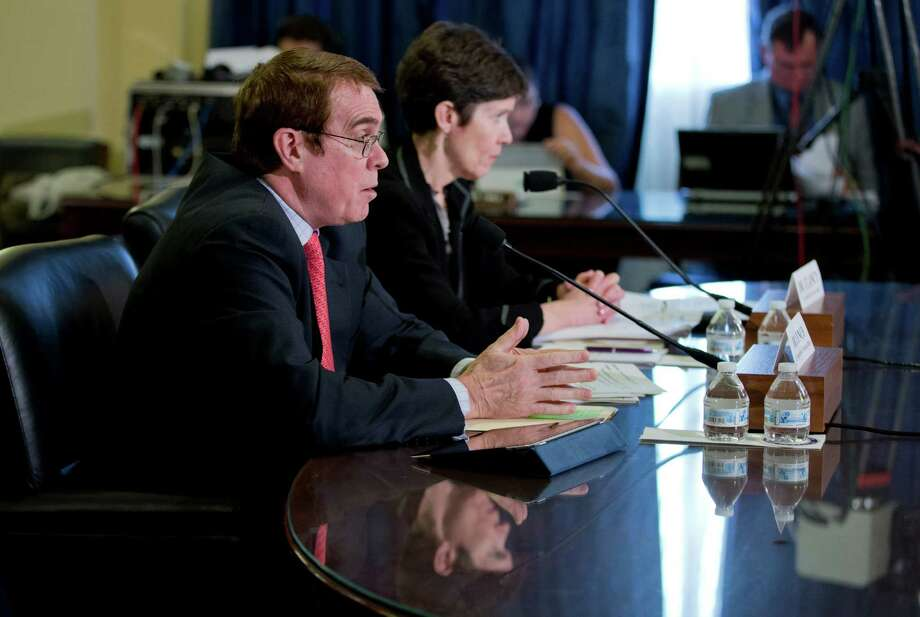 """Assistant Deputy Under Secretary for Health for Clinical Operations, Veterans Health Administration of the Department of Veterans Affairs Thomas Lynch, left, with Assistant Deputy Under Secretary for Quality, Safety, and Value, Veterans Health Administration Carolyn Clancy, testifies during a House Committee on Veterans' Affairs hearing on """"Evaluating the Capacity of the VA to Care for Veteran Patients"""" on Capitol Hill in Washington, Monday, June 23, 2014.  (AP Photo/Manuel Balce Ceneta) Photo: Manuel Balce Ceneta, STF / AP"""
