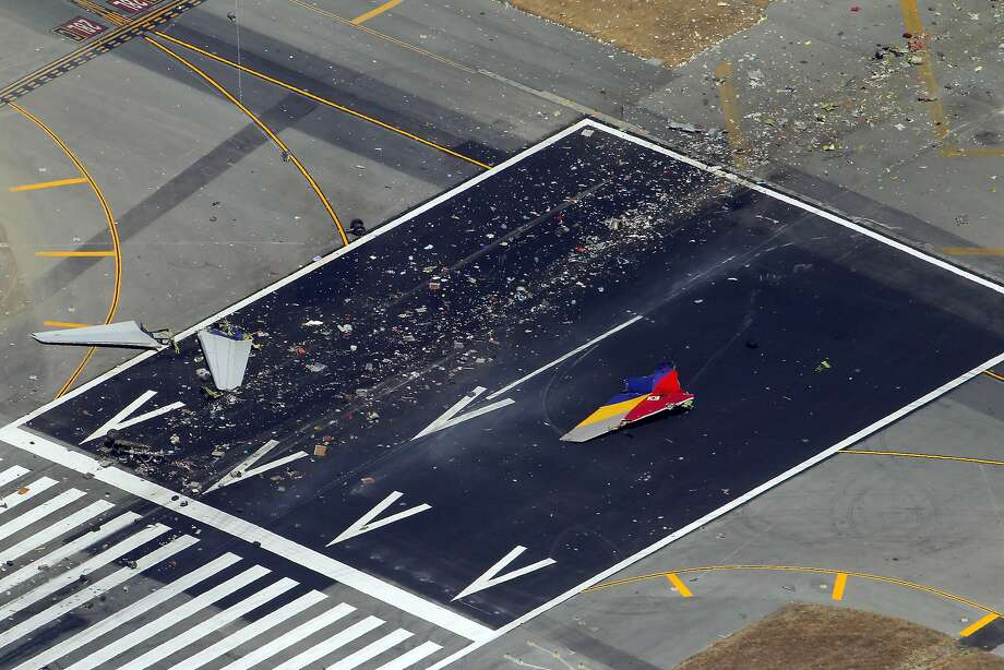 Debris from the July 2013 crash lies on the runway. The pilots were too dependent on automated systems they didn't understand, the report found. Photo: Carlos Avila Gonzalez, The Chronicle