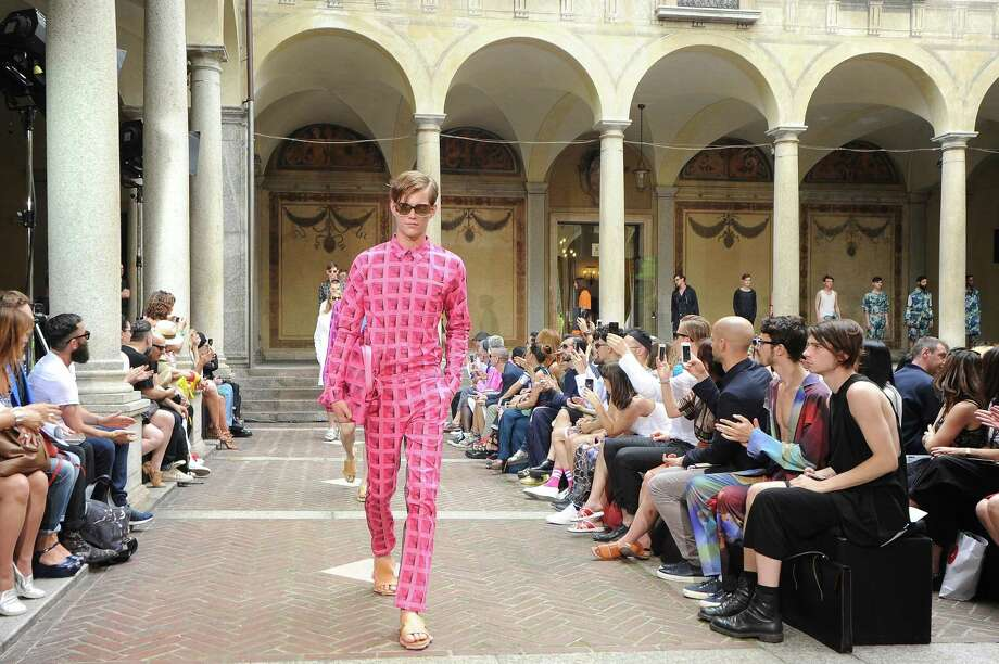 It's Milan Fashion Week which means we get to show you what not to wear for the season. They may call it fashion, but we call it a malfunction.The pepto-suitA new trend that seems to be taking off this season is ridiculous colors paired with interesting patterns. If you choose to wear this be aware that you might not be able to get lost in the crowd.  Photo: Pier Marco Tacca, Getty / 2014 Getty Images
