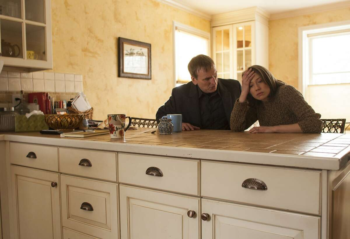 """HBO 2014 The Leftovers Episode 103 """"Two Boats and a Helicopter"""" Characters- Christopher Eccleston- Reverend Matt Jamison Carrie Coon- Nora Durst"""