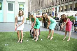 """NEW YORK, NY - JUNE 24: Michelle Wie (2nd R), 2014 U.S. Women's Open Golf Champion, with hosts Heather Nauert, Elisabeth Hasselbeck and Maria Molina, play golf at """"FOX And Friends"""" at FOX Studios on June 24, 2014 in New York City."""