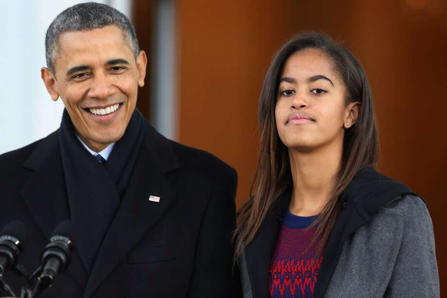 """U.S. President Barack Obama delivers remarks with his daughter Malia Obama, 15, before pardoning the 2013 National Thanksgiving Turkey, """"Popcorn"""" on the North Portico of the White House November 27, 2013 in Washington, DC. A 38-pound, full-grown Broad Breasted White domesticated turkey, """"Popcorn"""" and its alternate """"Caramel"""" will be sent to live at Mount Vernon, the estate and home of George Washington. Photo: Chip Somodevilla, Getty Images"""