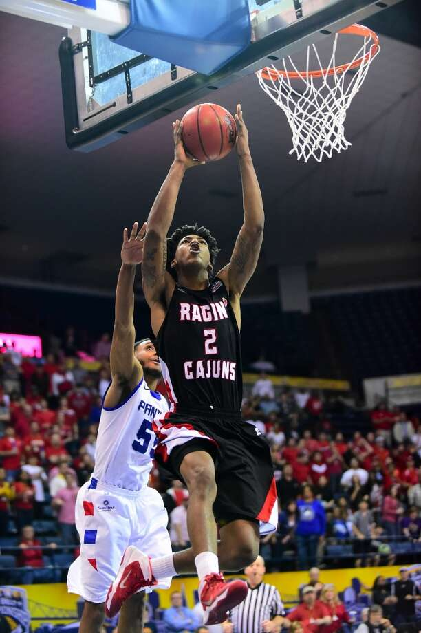 Guard  Elfrid Payton, 6-4, Louisiana-Lafayette  One of the top risers in the draft, Payton has excelled in workouts, giving him a chance to match up and more than hold his own with top backcourt prospects. Photo: Michael Chang, Getty Images