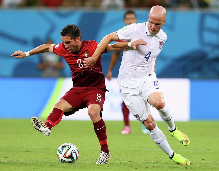 Michael Bradley, right, has been in the spotlight in Brazil for the wrong reasons - a subpar game against Ghana and an untimely mistake against Portugal. Photo: Kevin C. Cox, Staff / 2014 Getty Images