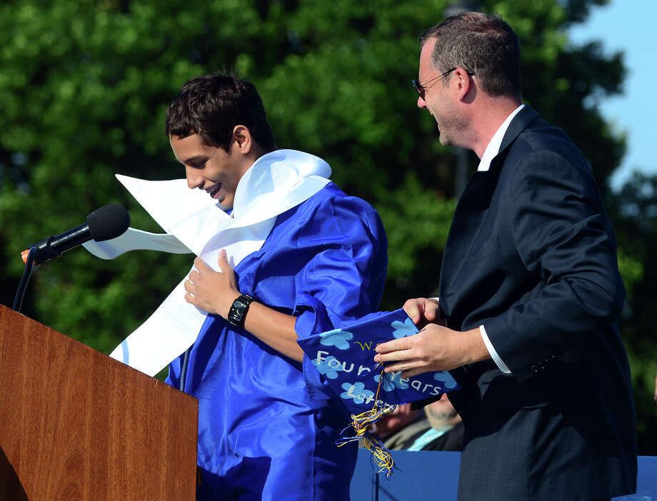 Valedictorian Hector Reyes-Perez has a little trouble with the wind as he speaks, during Warren Harding High School's 88th Annual Commencement Ceremony held at Central High School's Kennedy Stadium in Bridgeport, Conn. on Tuesday June 24, 2014. Photo: Christian Abraham / Connecticut Post