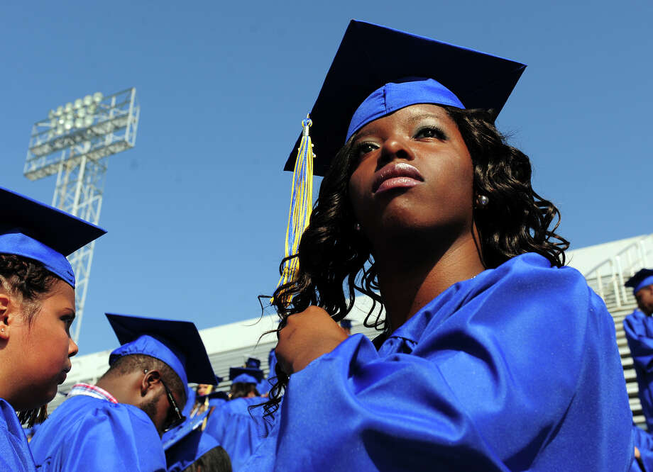 Graduate Allison Clark looks out to see if she can spot her family before the start of Warren Harding High School's 88th Annual Commencement Ceremony held at Central High School's Kennedy Stadium in Bridgeport, Conn. on Tuesday June 24, 2014. Photo: Christian Abraham / Connecticut Post