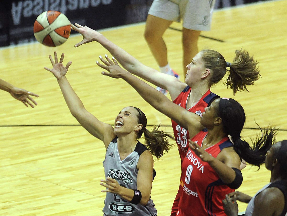 Becky Hammon of the San Antonio Silver Stars shoots a layup as Emma Messerman (33) and Kia Vaughn of the Washington Mystics defend during WNBA action in the Alamodome on Tuesday, June 24, 2014.