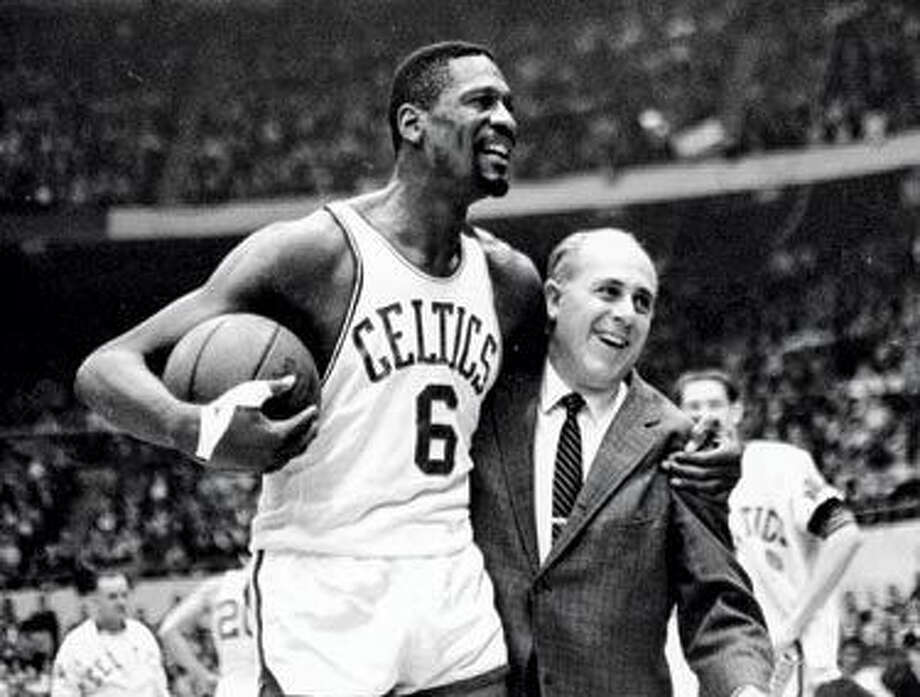 Boston Celtics' Bill Russell with coach Red Auerbach. Photo: Associated Press File Photo