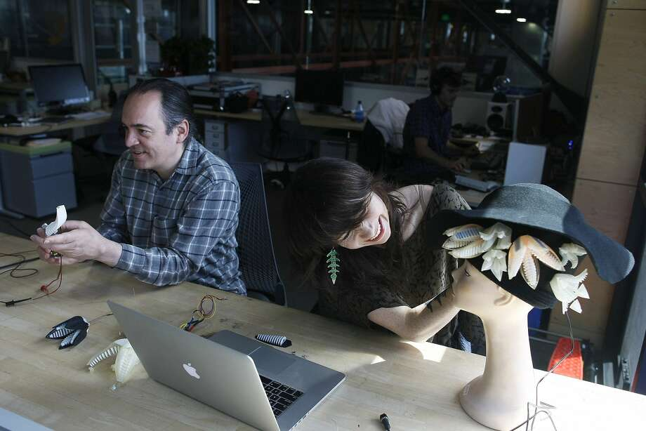 Artists in residence Paolo Salvagione (left) and Mikaela Holmes work on their pieces at Autodesk, which has opened its program to more than 40 artists. Photo: James Tensuan, The Chronicle