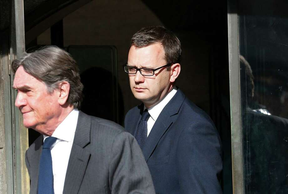 Andy Coulson, right, former News of the World editor, was the only defendant found guilty Tuesday of conspiring to hack phones. Photo: Lefteris Pitarakis, STF / AP