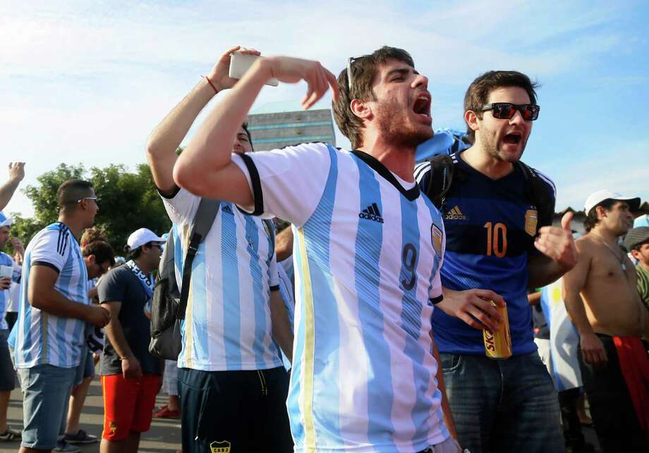 Argentina fans begin to gather in Porto Alegre, a day before their team's game against Nigeria. Officials in the city were bracing for 80,000 Argentine fans and the possible problems involved with only 20,000 of them holding tickets. Photo: Pedro Garcia, STR / AP