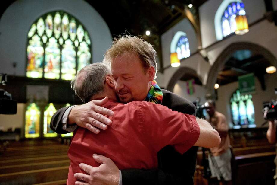 United Methodist pastor Frank Schaefer, right, has vowed to press for gay rights in the church. Photo: Matt Rourke, STF / AP