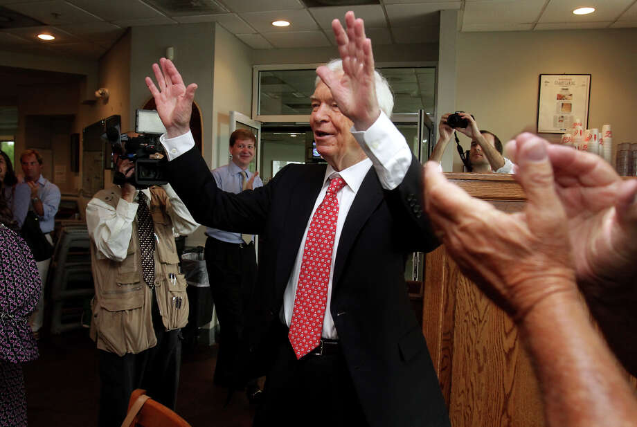 Sen. Thad Cochran greets supporters as they cheer his entrance at McElroy's in Ocean Springs, Miss., on Tuesday, June 24, 2014. Voters go to the polls Tuesday to vote in the Republican primary runoff election between incumbent Cochran and challenger Chris McDaniel. (AP Photo/Sun Herald, Amanda McCoy) LOCAL TELEVISION OUT; MANDATORY CREDIT: MISSISSIPPI PRESS OUT; LOCAL TELEVISION OUT WLOX, LOCAL ONLINE OUT; GULFLIVE.COM OUT Photo: AMANDA McCOY, MBR / The Sun Herald