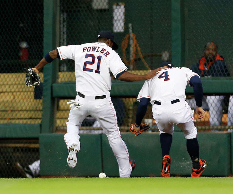 Astros center fielder Dexter Fowler (21) receives some unneeded company from George Springer in chasing down a double by the Braves' Chris Johnson. Photo: Karen Warren, Staff / © 2014 Houston Chronicle