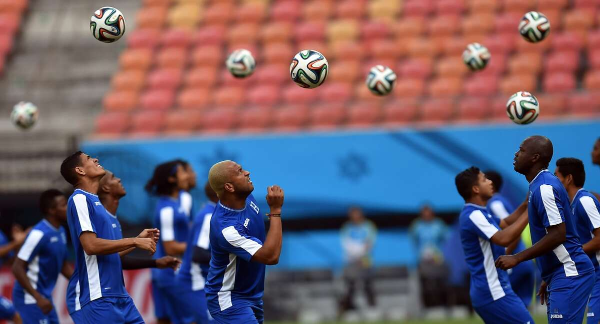TOPSHOTS Honduras' players take part in an official training session at the Amazonia Arena stadium in Manaus on June 24, 2014, on the eve of their group E FIFA World Cup football match against Switzerland. AFP PHOTO/ Rodrigo ARANGUARODRIGO ARANGUA/AFP/Getty Images