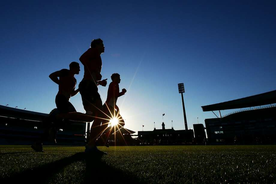 SYDNEY, AUSTRALIA - JUNE 24:  (L-R) Josh Kennedy, Mike Pyke and Kurt Tippett of the Swans run during a Sydney Swans AFL training session at Sydney Cricket Ground on June 24, 2014 in Sydney, Australia.  (Photo by Matt King/Getty Images) *** BESTPIX *** Photo: Matt King, Getty Images