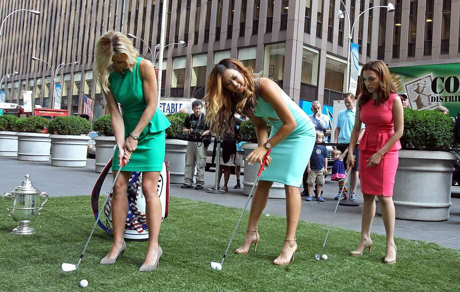 NEW YORK, NY - JUNE 24: Michelle Wie (C) winner of the U.S. Women's Open shows off her putting stance with host's Elisabeth Hasselbeck (L) and Maria Molina while appearing on FOX's 'Fox and Friends' show during her Media Tour June 24, 2014 in New York City. (Photo by Adam Hunger/Getty Images) Photo: Adam Hunger, Getty Images