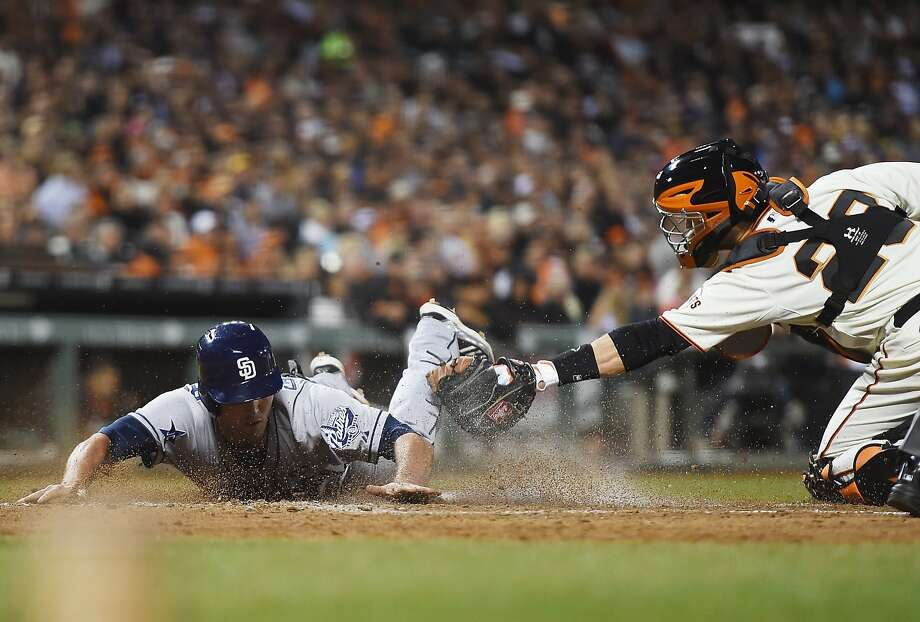 SAN FRANCISCO, CA - JUNE 24:  Jake Goebbert #4 of the San Diego Padres scores, beating the tag of Buster Posey #28 of the San Francisco Giants in the top of the sixth inning at AT&T Park on June 24, 2014 in San Francisco, California. Goebbert scored on a two-run rbi single from Alexi Amarista. (Photo by Thearon W. Henderson/Getty Images) Photo: Thearon W. Henderson, Getty Images