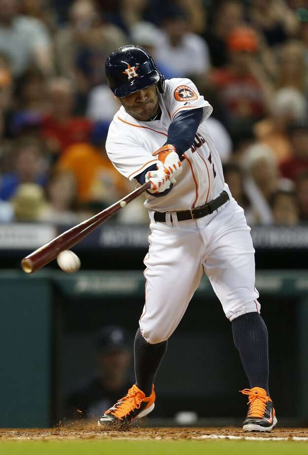 June 24: Braves 3, Astros 2  Astros second baseman Jose Altuve (27) hits a single. Photo: Karen Warren, Houston Chronicle