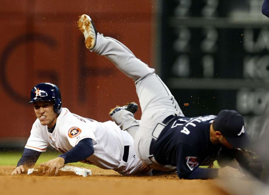 Astros right fielder George Springer (4) is out at second by Braves second baseman Tommy La Stella (7) on a double play. Photo: Karen Warren, Houston Chronicle