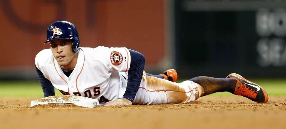 Astros right fielder George Springer (4) reacts on second after Jon Singleton grounded into a double play. Photo: Karen Warren, Houston Chronicle