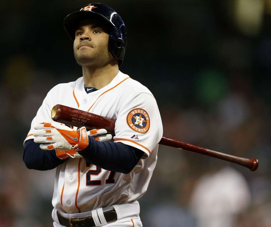 Astros second baseman Jose Altuve (27) reacts to hitting a foul ball. Photo: Karen Warren, Houston Chronicle