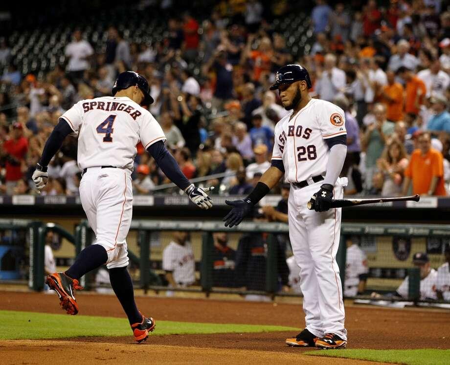 Astros right fielder George Springer (4) celebrates his solo home run with Jon Singleton (28). Photo: Karen Warren, Houston Chronicle