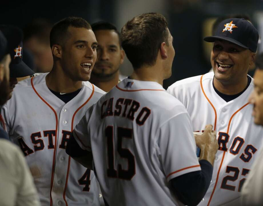 The Astros celebrate Jason Castro's (15) run scored on an RBI single by Jonathan Villar. Photo: Karen Warren, Houston Chronicle
