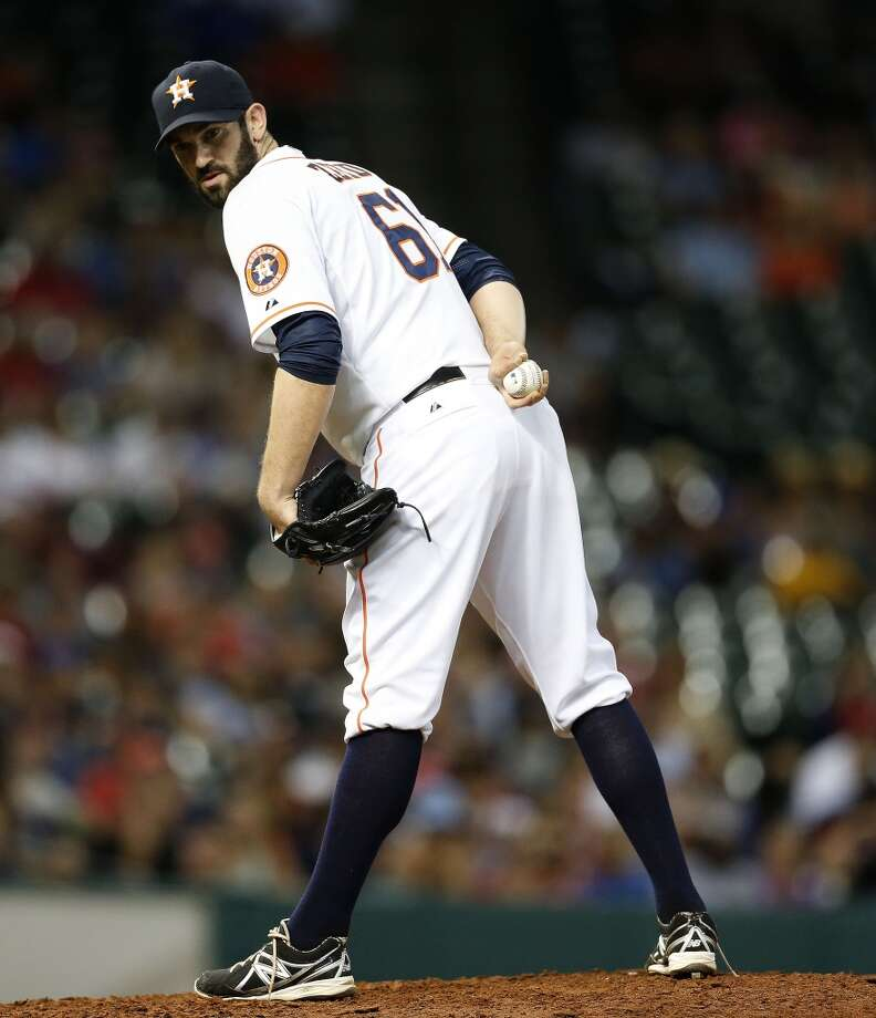Astros relief pitcher Josh Zeid (61) checks the runner at first base. Photo: Karen Warren, Houston Chronicle