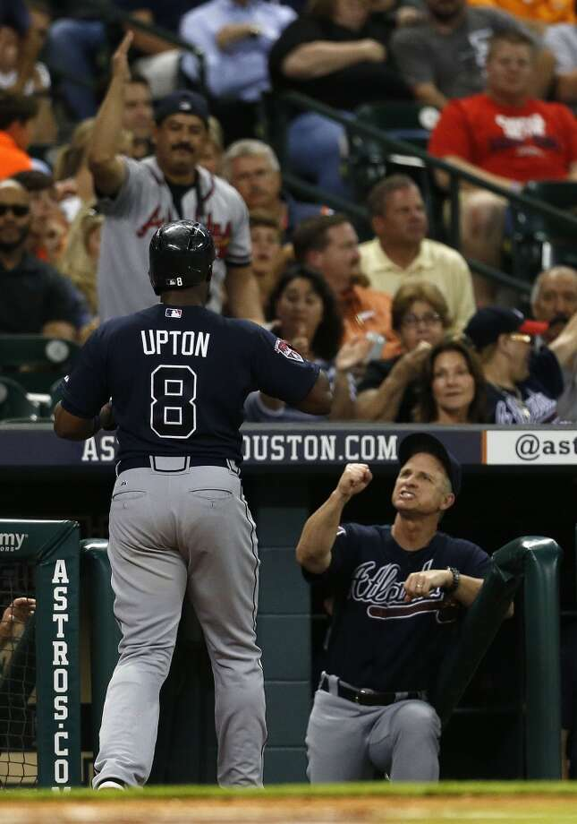 Braves left fielder Justin Upton (8) celebrates his home run at the dugout. Photo: Karen Warren, Houston Chronicle