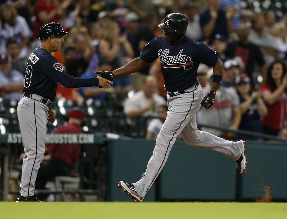 Braves left fielder Justin Upton (8) celebrates his home run as he rounds the bases. Photo: Karen Warren, Houston Chronicle