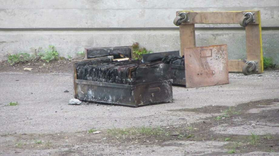 Burned filing cabinets can be seen outside a warehouse that burn at 8 Erie Boulevard in Albany early Wednesday morning. The building is located between North Ferry Street and North Lawrence streets. (Bob Gardinier / Times Union)