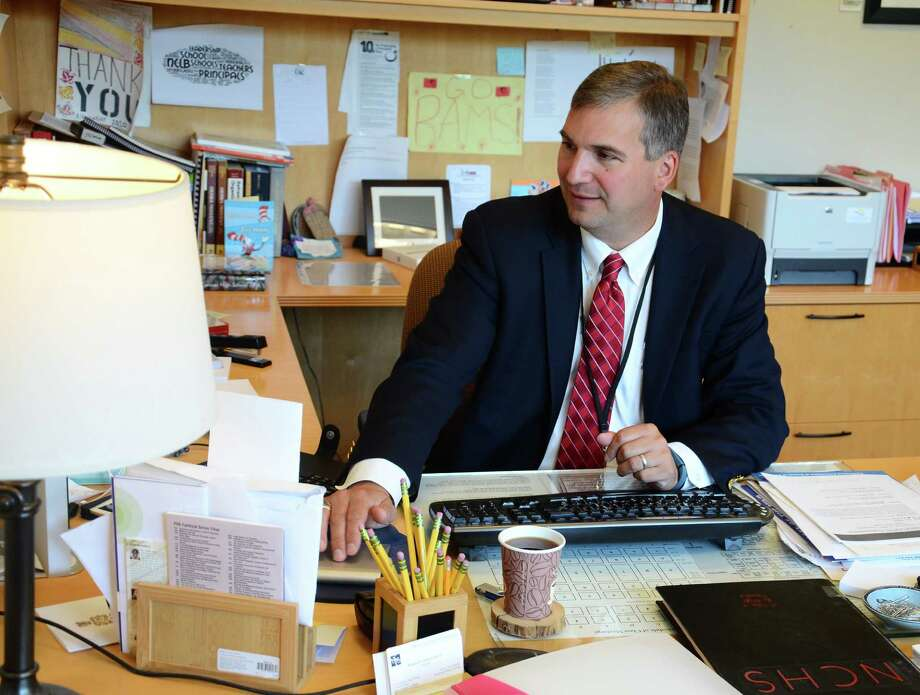 Principal Bryan Luizzi works in his office Monday, June 23, 2014, at New Canaan High School , in New Canaan, Conn. Luizzi is replacing retiring Superintendent of Schools Mary Kolek July 1 as an interim superintendent. Photo: Nelson Oliveira / New Canaan News