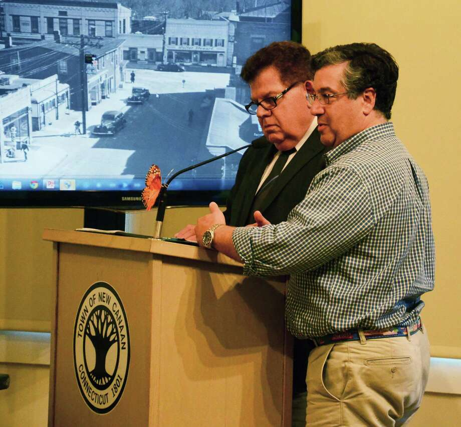 South Western Regional Planning Agenc's Executive Director Floyd Lapp, left, and First Selectman Robert Mallozzi address the Town Council June 18, 2014, at the New Canaan Nature Center, in New Canaan, Conn. At the meeting, the council approved an ordinance to allow the town to join the newly-formed Western Connecticut Council of Governments. Photo: Nelson Oliveira / New Canaan News