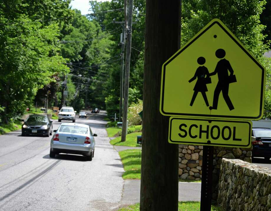 A sidewalk will be built this summer on the south side of Old Norwalk Road between Kiwanis Park and the intersection with Main Street in New Canaan, Conn., according to Assistant Director of Public Works Tiger Mann. The stretch has been a growing concern of neighbors because of the volume of children who walk in the area. Photo: Nelson Oliveira / New Canaan News