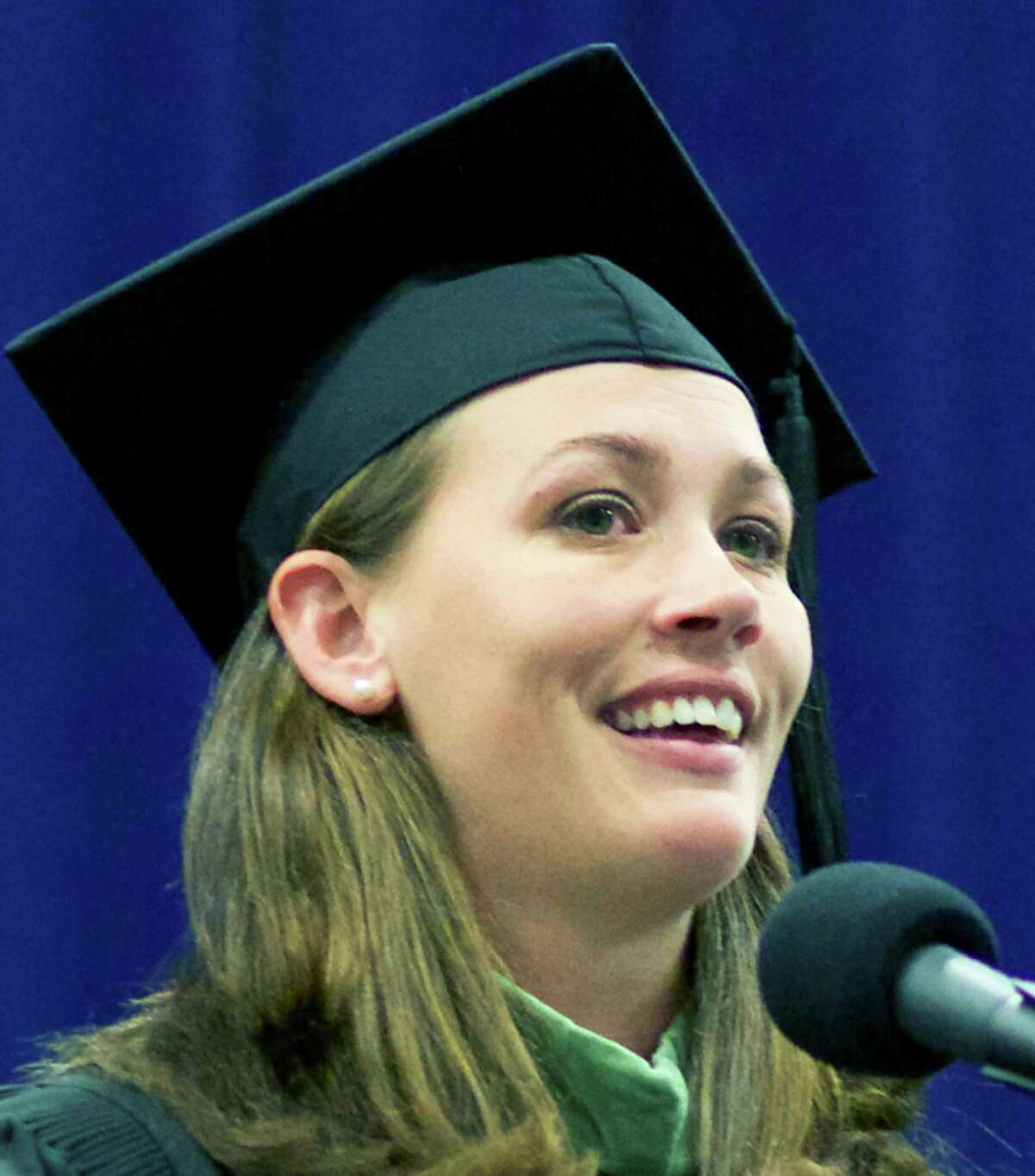 NMHS faculty member Erica Keane offers the graduates sage advice, mixed with a bit of good humor, during New Milford High School's June 21 commencement ceremony for the Class of 2014 at the O'Neill Center on the westside campus of Western Connecticut State University in Danbury.