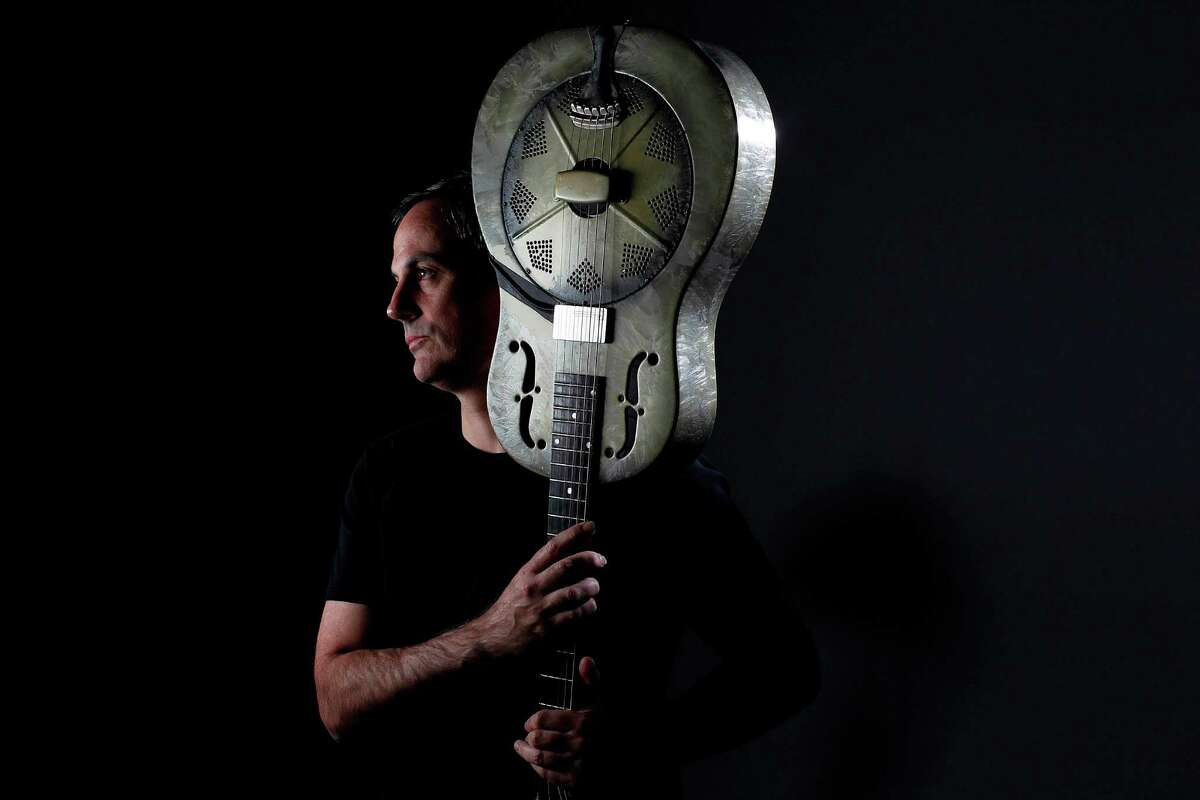 John Egan, a local blues guitarist, launched a new album called Phantoms on Friday, Feb. 10, 2012, in Houston. Egan's trade maker is a National steel guitar. ( Mayra Beltran / Houston Chronicle )