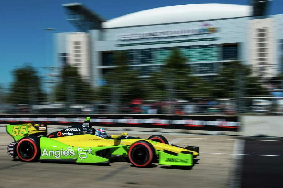 IndyCar driver Tristan Vautier (55) races past Reliant Stadium during the second IndyCar Grand Prix of Houston auto race on Sunday, Oct. 6, 2013, in Houston. ( Smiley N. Pool / Houston Chronicle ) Photo: Smiley N. Pool, Staff / © 2013  Houston Chronicle