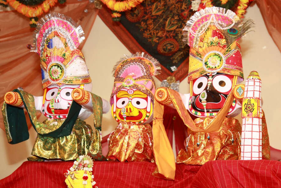 Ratha Yatra, the ancient festival of the chariots, will take place for the first time in Houston on July 12 at India House, 8888 Bellfort. Devotees will pull a 22-foot-tall chariot carrying a representation of Lord Jagannatha (a name for God in the ancient Vedic culture) and two other deities in a procession around the perimeter of the 10-acre India House. From left to right in photo they are Lord Jagannatha, (Jagath means universe, nath means Lord) Balaram, (his elder brother) and Subhadhra ( his sister)...They will all be on the chariot Photo: Dr. Raghu Dass / Email