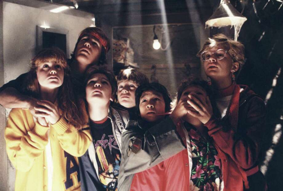"Kerri Green, from left, Josh Brolin, Corey Feldman, Sean Aastin, Ke Huy-Quan, Jeff B. Cohen and Martha Plimpton star in ""The Goonies."" / handout slide"