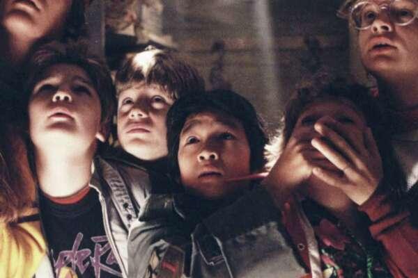 "Kerri Green, from left, Josh Brolin, Corey Feldman, Sean Aastin, Ke Huy-Quan, Jeff B. Cohen and Martha Plimpton star in ""The Goonies."""